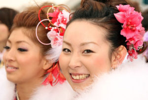 TOKYO - JANUARY 11: Japanese twenty-year-old women, dressed in traditional kimonos, pose for photographs during the annual Coming-of-Age Day ceremony at Toshimaen Amusement Park on January 11, 2010 in Tokyo, Japan. 1.27 million young people celebrate their passage into adulthood on the day while they become eligible to drink alcohol, smoke and vote at the age of 20. (Photo by Koichi Kamoshida/Getty Images)