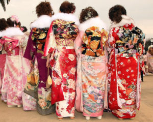 TOKYO - JANUARY 11: Japanese twenty-year-old women, dressed in traditional kimonos, attend the annual Coming-of-Age Day ceremony at Toshimaen Amusement Park on January 11, 2010 in Tokyo, Japan. 1.27 million young people celebrate their passage into adulthood on the day while they become eligible to drink alcohol, smoke and vote at the age of 20. (Photo by Koichi Kamoshida/Getty Images)