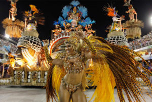 A reveller from the Vila Isabel samba school parades on the first night of the annual Carnival parade in Rio de Janeiro's Sambadrome February 20, 2012. REUTERS/Nacho Doce (BRAZIL - Tags: SOCIETY ENTERTAINMENT)