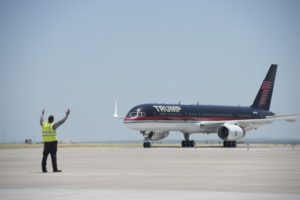 LAREDO, TEXAS - JULY 23: Republican Presidential candidate and business mogul Donald Trump arrives on his plane during his campaign trip to the border on July 23, 2015 in Laredo, Texas. Trump's recent comments, calling some immigrants from Mexico as drug traffickers and rapists, have stirred up reactions on both sides of the aisle. Although fellow Republican presidential candidate Rick Perry has denounced Trump's comments and his campaign in general, U.S. Senator from Texas Ted-Cruz has so far refused to bash his fellow Republican nominee. Matthew Busch/Getty Images/AFP == FOR NEWSPAPERS, INTERNET, TELCOS & TELEVISION USE ONLY ==