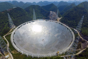 epa05324800 A picture made available on 23 May 2016 shows a general view on the five-hundred-meter Aperture Spherical radio Telescope (FAST) under construction in the remote Pingtang county, southwest China's Guizhou province, 07 May 2016. The project, one of China's nine most important scientific research facilities, will be the world's largest radio telescope. The 250,000 square meters of reflective surface will be completed by May 30. EPA/STR CHINA OUT