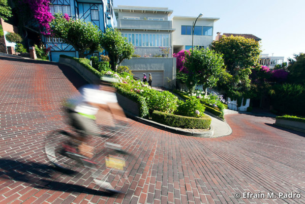 """Bicycle rider on Lombard Street (""""Crookedest Street""""), San Francisco, California"""