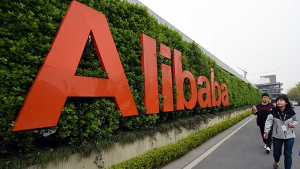 (Newscom) IT12-baba-061416-newscom (160321) -- HANGZHOU, March 21, 2016 (Xinhua) -- People walk past a logo of China's e-commerce giant Alibaba in Hangzhou, capital of east China's Zhejiang Province, March 21, 2016. Alibaba China retail marketplaces real-time gross merchandize value (GMV) in fiscal year 2016 reached three trillion RMB (about 463 billion U.S. dollars) at 2:58 p.m. (0658 GMT) on March 21, 2016. This means Alibaba Group, China's leading e-commerce company, might exceed Wal-Mart and become the world's biggest retail platform in fiscal year 2016, according to analysis. (Xinhua/Wang Dingchang)(wjq) (Newscom TagID: xnaphotos622094.jpg) [Photo via Newscom]
